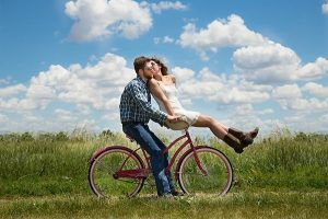 a couple on a bike in a happy relationship